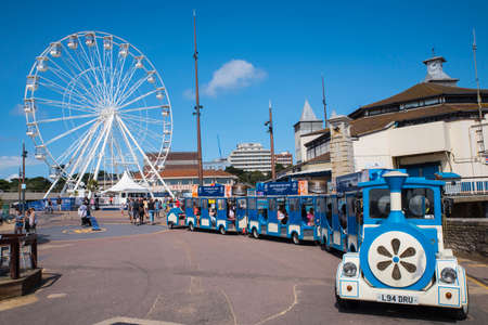 BOURNEMOUTH, UK - AUGUST 17TH 2017: A view of the Bournemouth Big Wheel and coastal train on Bournemouth seafront in Dorset, UK, on 17th August 2017. Editorial