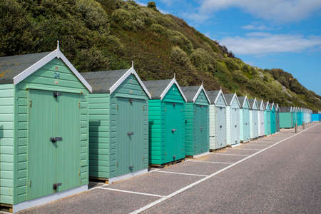 A row of classic beach huts on Bournemouth seafront in Dorset, UK. Editorial