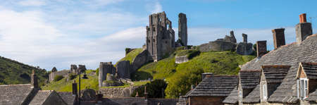 DORSET, UK - AUGUST 16TH 2017: A view of the remains of the stunning Corfe Castle in Dorset, UK, on 16th August 2017. Editorial