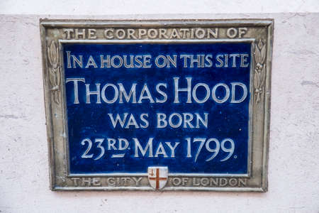 LONDON, UK - AUGUST 25TH 2017: A blue plaque marking the location where English poet and author Thomas Hood was born in London in 1799, taken on 25th August 2017.