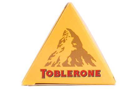 LONDON, UK - DECEMBER 18TH 2017: A close up of the Toblerone logo on the products packaging, on 18th December 2017.  Toblerone is a Swiss chocolate bar brand owned by Mondelez International Inc. Editorial