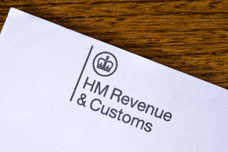 LONDON, UK - DEC 18TH 2017: The symbol for HM Revenue and Customs on the top of a letterhead, on 18th December 2017. HM Revenue and Customs is a non-ministerial department of the UK Government responsible for the collection of taxes.