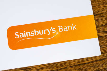 LONDON, UK - DEC 18TH 2017: The Sainsburys Bank logo, pictured on a promotional leaflet, on 18th December 2017.  Sainsburys Bank is a British bank owned by the national supermarket chain Sainsburys. Editorial