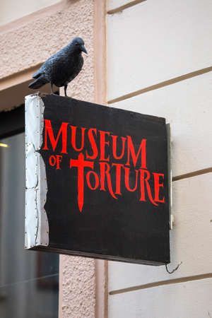 PRAGUE, CZECH REPUBLICH - DECEMBER 23RD 2017: A sign above the entrance to the Museum of Torture, located in the old town area of the city of Prague, Czech Republic, on 23rd December 2017