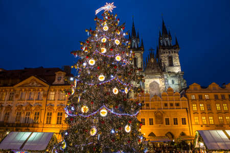 PRAGUE, CZECH REPUBLIC - DEC 21ST 2017: The Christmas tree and market in the Old Town Square in Prague, on 21st December 2017.  The towers of Tyn Church can be seen in the background. Editorial