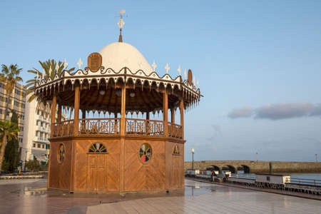 A bandstand on the promenade in the historic city of Arrecife - the capital of Lanzarote in Spain.  The lower level of the bandstand is a tourist information. Stock Photo - 95098866