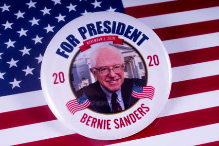 LONDON, UK - MARCH 18TH 2018: A Bernie Sanders badge over the USA flag, symbolizing his potential candidacy to run for President in 2020, taken on 18th March 2018.