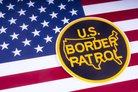 LONDON, UK - MARCH 18TH 2018: The symbol of the US Border Patrol pictured over the USA Flag, on 18th March 2018.  The USBP is an American federal law enforcement agency.