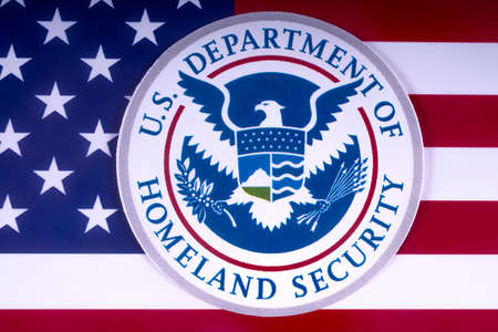 LONDON, UK - MARCH 18TH 2018: The symbol of the US Department of Homeland Security pictured over the USA Flag, on 18th March 2018.