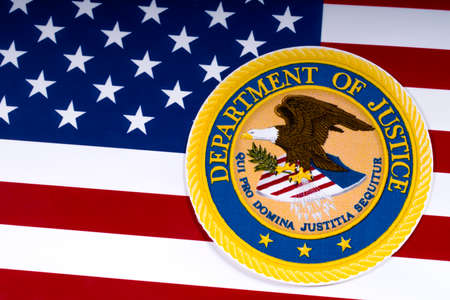 LONDON, UK - MARCH 26TH 2018: The symbol of the United States Department of Justice portrayed with the US flag, on 26th March 2018. Sajtókép