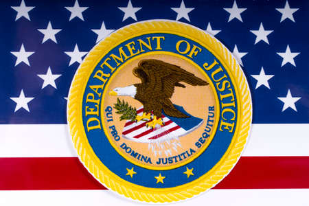 LONDON, UK - MARCH 26TH 2018: The symbol of the United States Department of Justice portrayed with the US flag, on 26th March 2018. Editorial