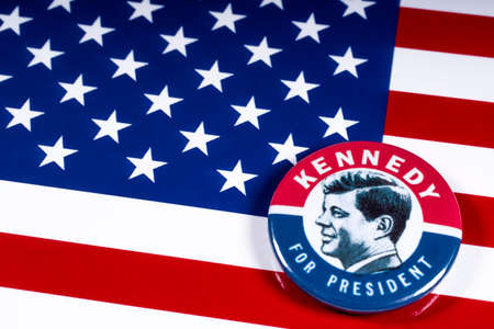LONDON, UK - MARCH 27TH 2018: A Kennedy For President badge pictured over the USA Flag, on 27th March 2018.  John F Kennedy was the 35th President of the United States of America. Editorial