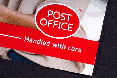 LONDON, UK - MARCH 27TH 2018: A close-up of the Post Office icon, pictured on an information leaflet, on 27th March 2018.  Post Office Ltd is a retail post office company in the UK. Redactioneel