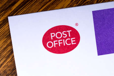 LONDON, UK - MARCH 27TH 2018: A close-up of the Post Office icon, pictured on a letterhead, on 27th March 2018.  Post Office Ltd is a retail post office company in the UK. Sajtókép