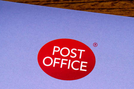 LONDON, UK - MARCH 27TH 2018: A close-up of the Post Office icon, pictured on an information leaflet, on 27th March 2018.  Post Office Ltd is a retail post office company in the UK. Editöryel