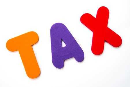 The word TAX spelt out with colourful letters.