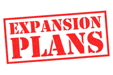 EXPANSION PLANS red rubber stamp over a white background. Фото со стока