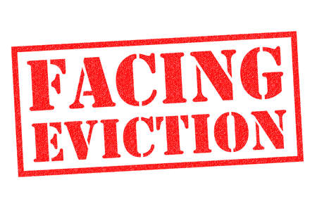FACING EVICTION red Rubber Stamp over a white background. Stok Fotoğraf