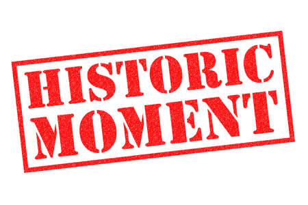 HISTORIC MOMENT red Rubber Stamp over a white background.