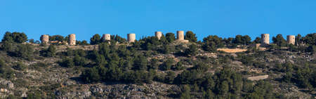 A view of the old Els Molins, also known as the Windmills, overlooking the town of Javea, or Xabia, in Spain. Stockfoto