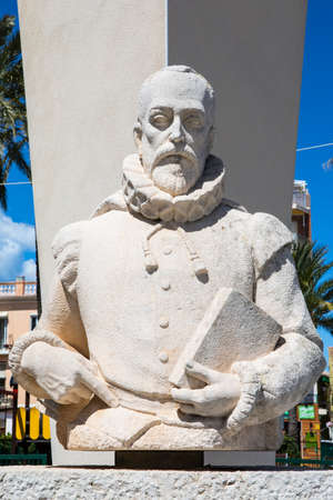 DENIA, SPAIN - APRIL 12TH 2018: A sculpture of famous Spanish writer Miguel de Cervantes, located in the historic city of Denia, in Spain, on 12th April 2018.