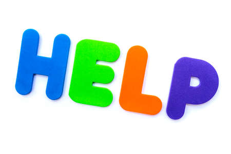 The word HELP spelt in multi-coloured letters. Stock Photo