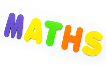 The word MATHS spelt in multi-coloured letters. Stock Photo