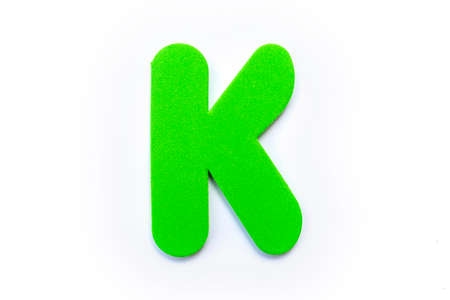 Green Letter K over a white background. Stock Photo