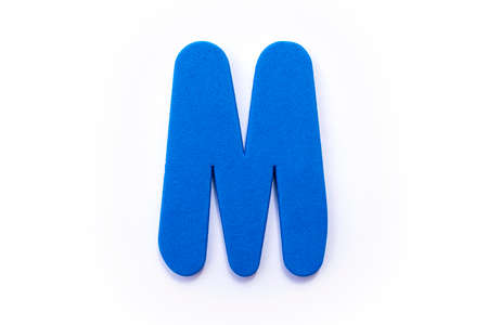 Blue Letter M over a white background.