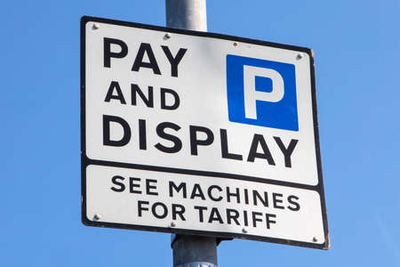 A Pay and Display Parking Sign.