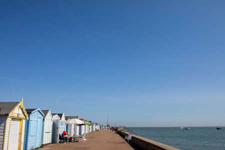 THORPE BAY, ESSEX - APRIL 18TH 2018: A view of the Beach Huts at Thorpe Bay in Southend-on-Sea in Essex, on 18th April 2018. Editoriali