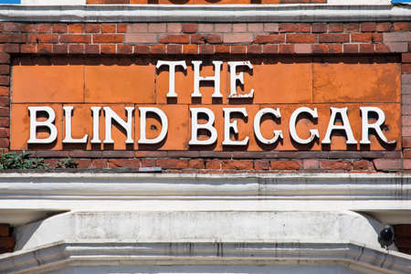 LONDON, UK - APRIL 19TH 2018: The original lettering on the exterior of The Blind Beggar public house on Whitechapel Road in London, on 18th April 2018. Its known to be the location of the murder of George Cornell by Ronnie Kray.