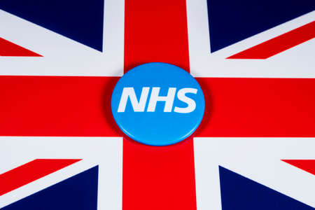 LONDON, UK - APRIL 27TH 2018: The National Health Service symbol over the UK flag, on 27th April 2018.  The NHS was established in 1948 as one of the major social reforms following the 2nd World War. Editorial