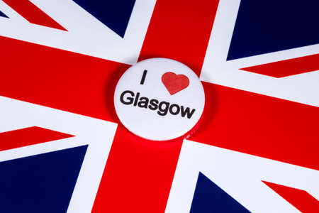 LONDON, UK - APRIL 27TH 2018: An I Love Glasgow badge pictured over the UK flag, on 27th April 2018.