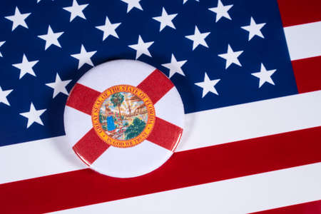 LONDON, UK - APRIL 27TH 2018: The symbol of the State of Florida, pictured over the flag of the United States of America, on 27th April 2018. Editorial