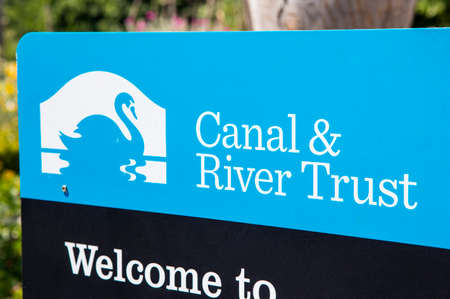 LONDON, UK - JULY 3RD 2018: A sign by the Canal and River Trust on the River Lea at Stonebridge Lock in Tottenham, London, on 3rd July 2018.