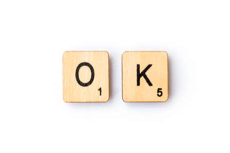 LONDON, UK - JUNE 28TH 2018: The word OK spelt out with wooden Scrabble letter tiles, on 28th June 2018. Sajtókép