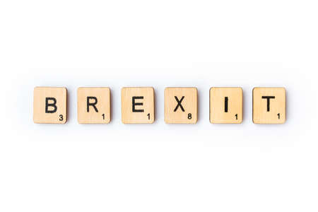 LONDON, UK - JUNE 28TH 2018: The word BREXIT spelt out with wooden letter Scrabble tiles, on 28th June 2018.