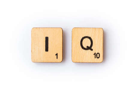 LONDON, UK - JUNE 28TH 2018: The abbreviation IQ - Intelligence Quotient, spelt with wooden letter Scrabble tiles, on 28th June 2018.