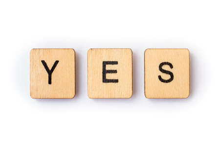 The word YES, spelt with wooden letter tiles.