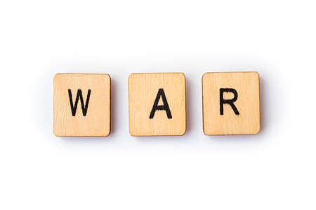 The word WAR, spelt with wooden letter tiles.