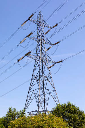 A view of an Electricity Pylon in the UK.  A pylon is a tall structure, used to support an overhead power line. Banco de Imagens