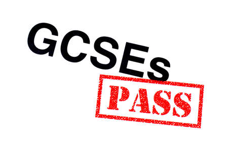 A GCSEs heading stamped with a red PASS rubber stamp. Imagens