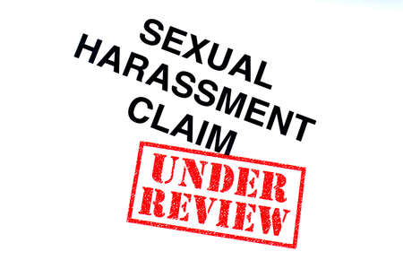 Sexual Harassment Claim heading stamped with a red UNDER REVIEW rubber stamp. Stock Photo