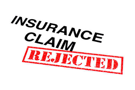 Insurance Claim heading stamped with a red REJECTED rubber stamp.