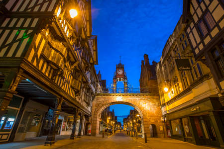 Chester, UK - July 31st 2018: A beautiful dusk-time view of the historic Eastgate Clock and the timber-framed architecture in the city of Chester in Cheshire, UK. Editorial