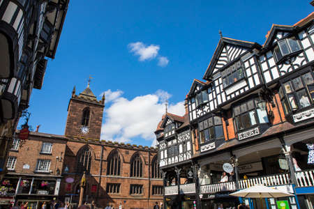 A view of St. Peters Church and the timber-framed buildings in the historic city of Chester in Cheshire, UK.