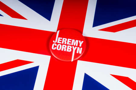 London, UK - November 20th 2018: A Jeremy Corbyn pin badge - leader of the British Labour Party, pictured over the flag of the United Kingdom.