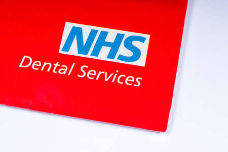 London, UK - November 14th 2018: A close-up of the NHS - National Health Service logo, pictured on an information leaflet about their Dental Services. 報道画像