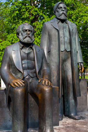 Berlin, Germany - April 17th 2011: Statue of Karl Marx and Friedrich Engels located in Marx-Engels-Forum in the city of Berlin, Germany. Marx and Engels were the authors of the Communist Manifesto of 1848.